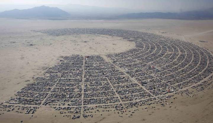An aerial view of the Burning Man 2013 arts and music festival is seen in the Black Rock Desert of Nevada, August 29, 2013. The federal government issued a permit for 68,000 people from all over the world to gather at the sold out festival, which is celebrating its 27th year, to spend a week in the remote desert cut off from much of the outside world to experience art, music and the unique community that develops. REUTERS/Jim Urquhart (UNITED STATES - Tags: SOCIETY) FOR EDITORIAL USE ONLY. NOT FOR SALE FOR MARKETING OR ADVERTISING CAMPAIGNS. NO THIRD PARTY SALES. NOT FOR USE BY REUTERS THIRD PARTY DISTRIBUTORS. FOR USE WITH BURNING MAN RELATED REPORTING ONLY