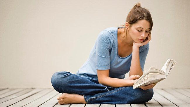 809281-woman-reading-book