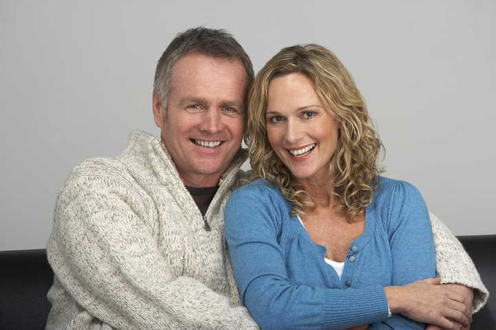 bigstock_Middle_Aged_Couple_Sitting_On__13899617_zps96cacc9a