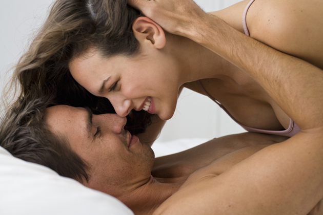 Sexual couple in bedroom